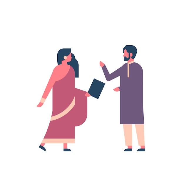 国民の伝統的な服を着ているインドのカップル Premiumベクター