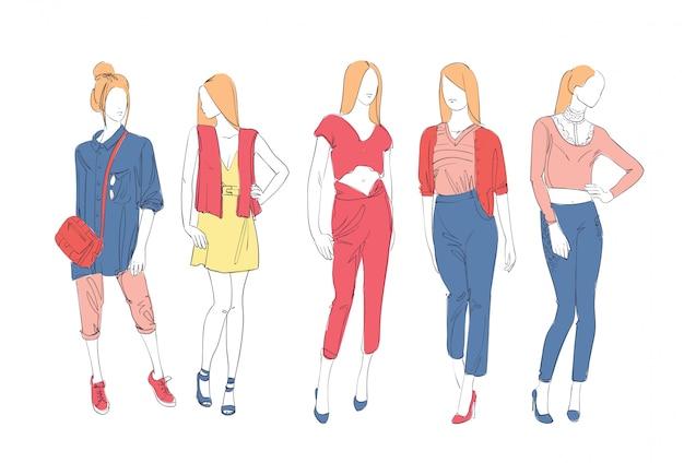 Модная коллекция одежды набор мужских и женских моделей, носящих модный эскиз одежды Premium векторы