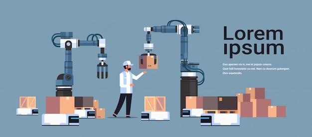 Человек инженер, управляющий роботизированными руками Premium векторы