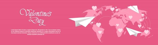 背景に世界地図と幸せなバレンタインデーバナー水平 Premiumベクター
