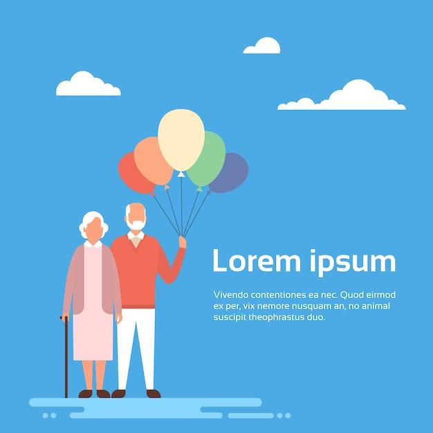 シニアカップル祖母と祖父ホールド空気バルーン Premiumベクター