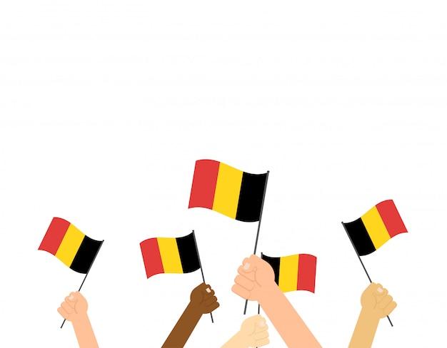 ベルギーの旗を手にして Premiumベクター