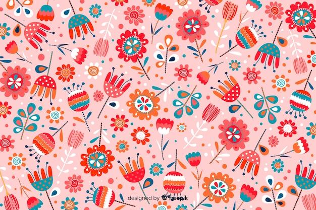 手描きの色とりどりの花の背景 無料ベクター