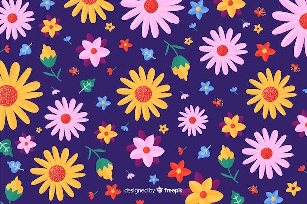 カラフルな平らな花の装飾的な背景 無料ベクター