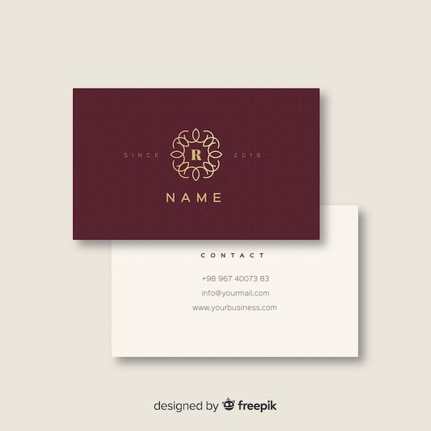 Бургундская и белая элегантная визитка Бесплатные векторы