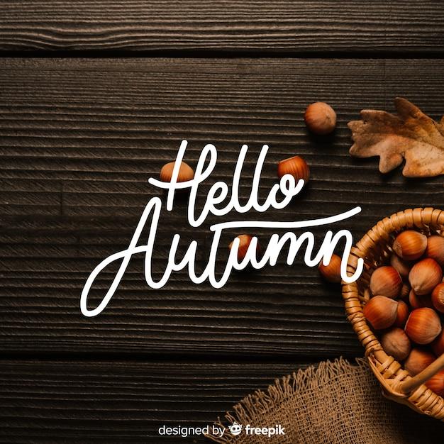 こんにちは写真と秋のレタリングの背景 無料ベクター
