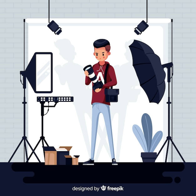 Профессиональный фотограф работает в студии Бесплатные векторы