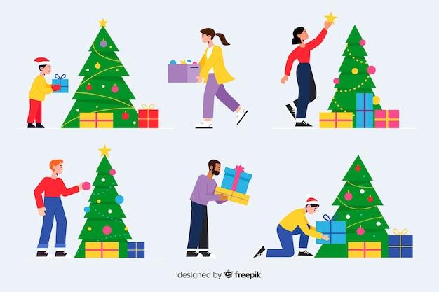 クリスマスツリーを飾るフラットなデザインの人々 無料ベクター