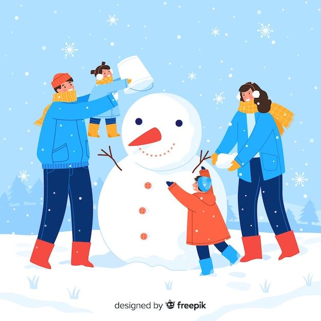 家族一緒に雪だるまを作る 無料ベクター