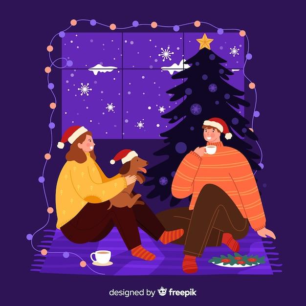 クリスマスの夜に一緒に滞在するカップル 無料ベクター