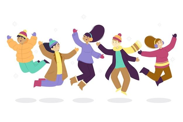 Молодые люди в зимней одежде прыгают Бесплатные векторы