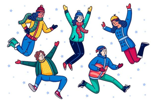 ジャンプする冬の服を着ている人 無料ベクター