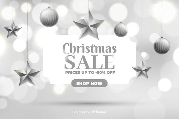Рождественская распродажа концепции с размытым фоном Бесплатные векторы
