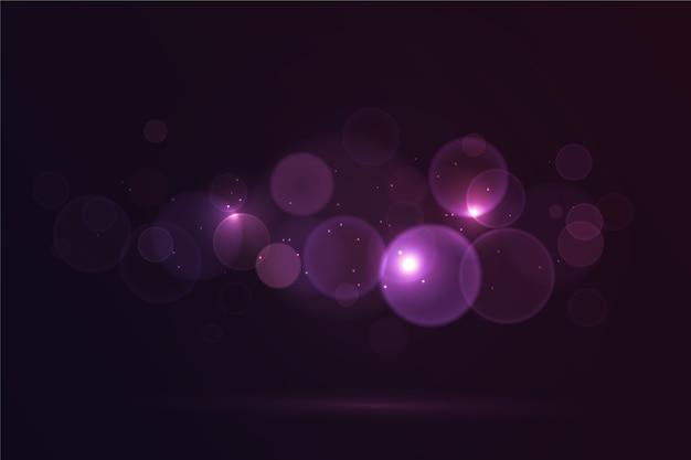 Боке световой эффект на темном фоне Бесплатные векторы