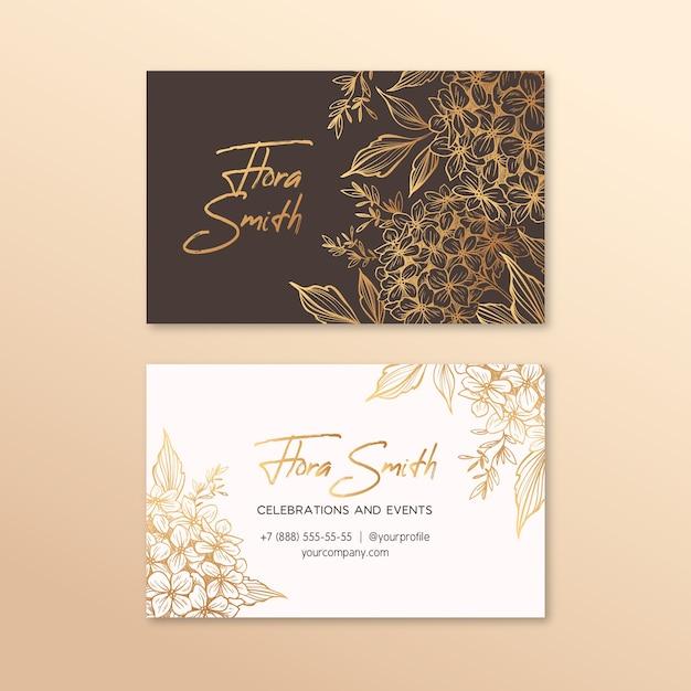 Креативная визитка с золотыми цветами Бесплатные векторы