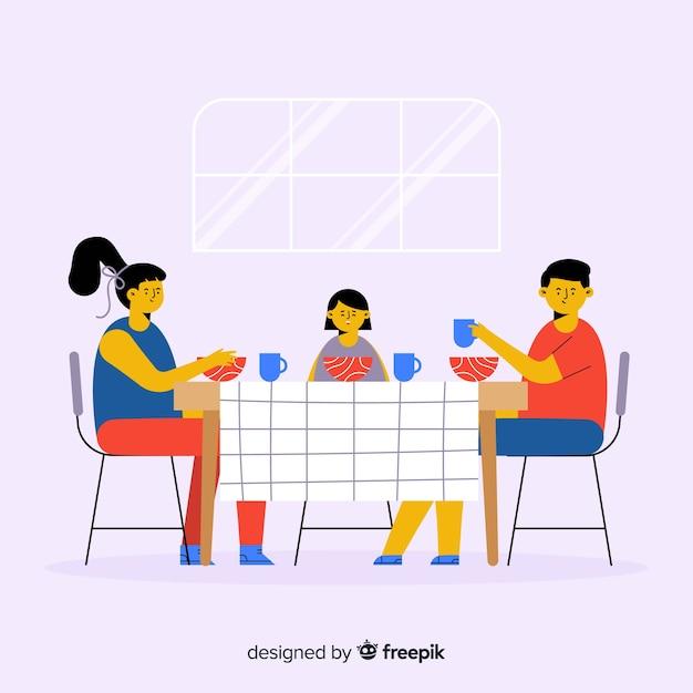 手描きの家族のテーブルの背景の周りに座って 無料ベクター