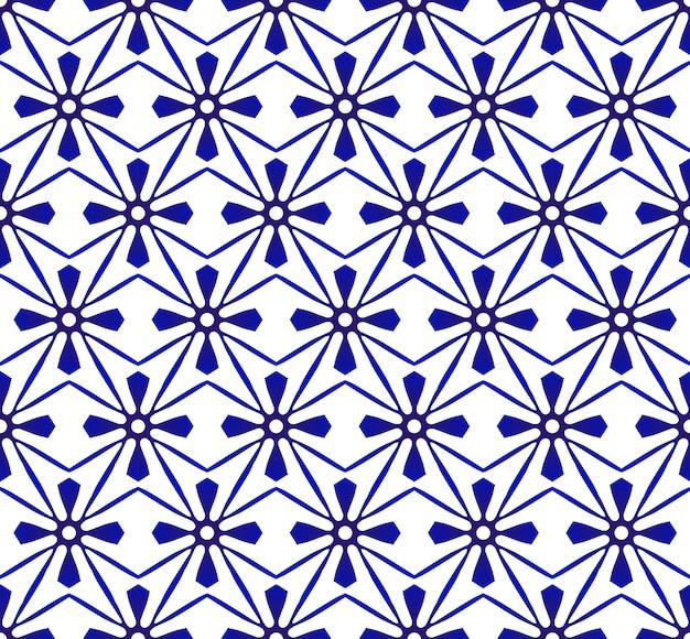 抽象的なモダンなパターンの青と白、磁器のシームレスな花柄 Premiumベクター