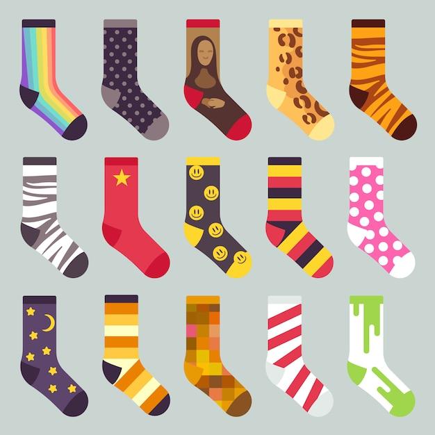 繊維のカラフルな子供の暖かい靴下。着色されたパターン、イラストと靴下のセット Premiumベクター