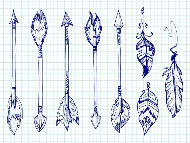 ボールペンの羽と矢印をノートブックページに設定 Premiumベクター