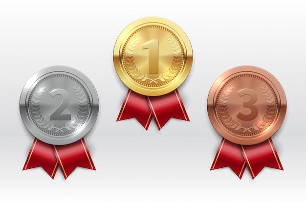 Золотые серебряные бронзовые медали. чемпион обладатель награды металлическая медаль. значки чести реалистичный изолированный набор Premium векторы