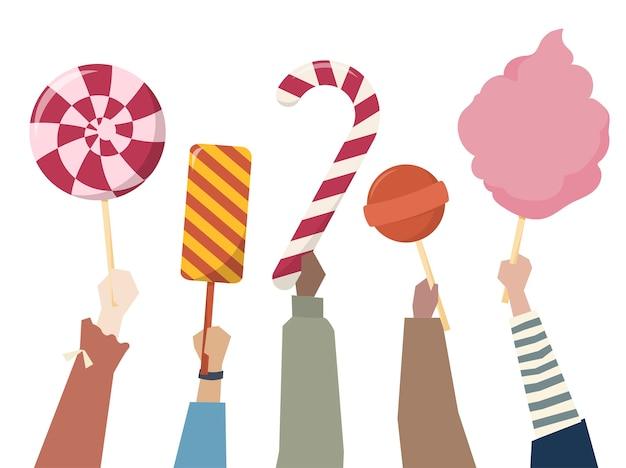 お菓子、キャンディーを手に持つ手 無料ベクター