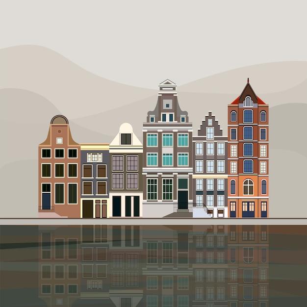 アムステルダムの伝統的なヨーロッパの運河の家 無料ベクター