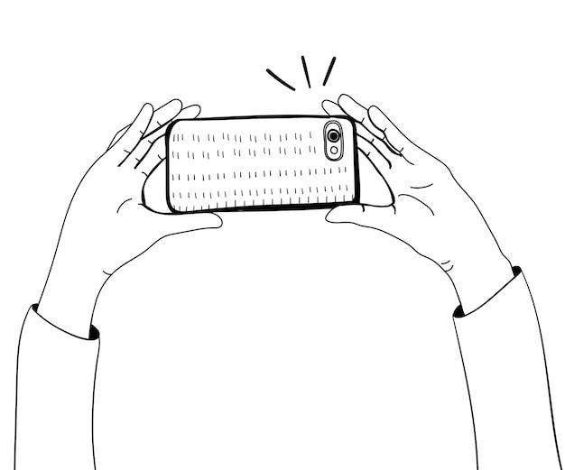 スマートフォンで写真を撮っている手のベクトル 無料ベクター