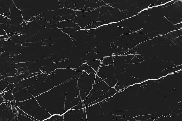 黒い大理石の背景のクローズアップ 無料ベクター