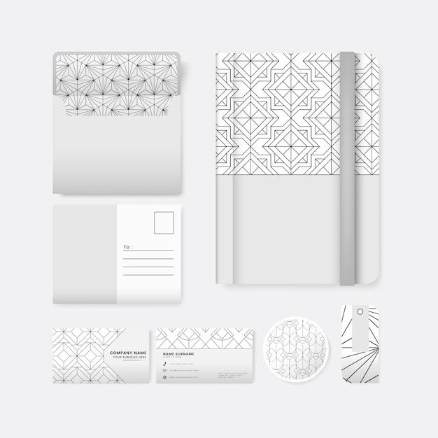 白い表面の文房具に黒い幾何学的パターンのセット 無料ベクター