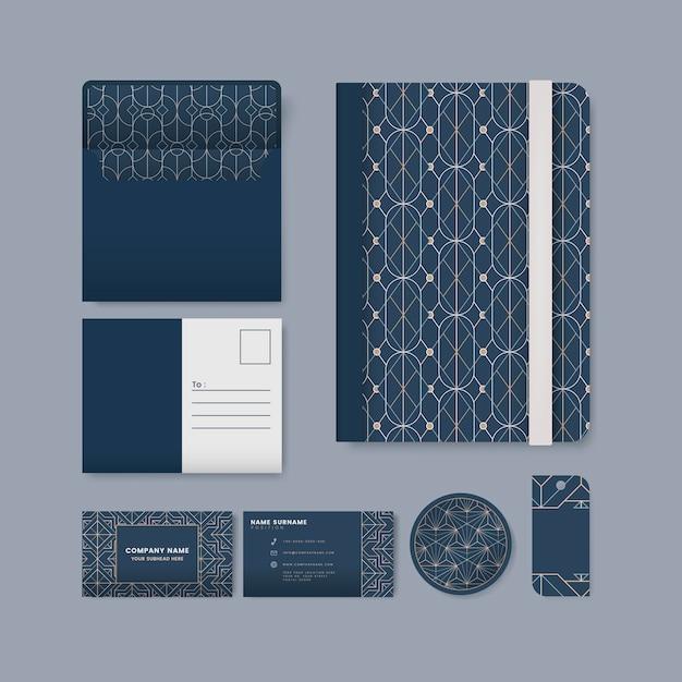 青い表面の文房具に白い幾何学的パターンのセット 無料ベクター