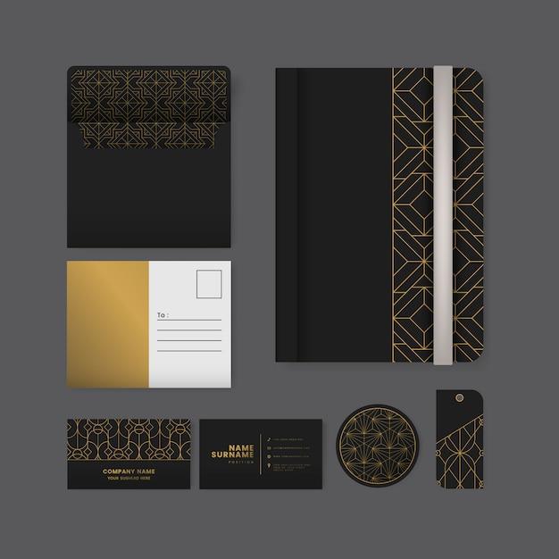 黒い表面の文具の金色の幾何学模様のセット 無料ベクター
