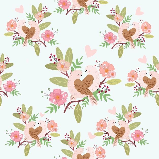 シームレスな花柄のかわいいカップル鳥。 Premiumベクター