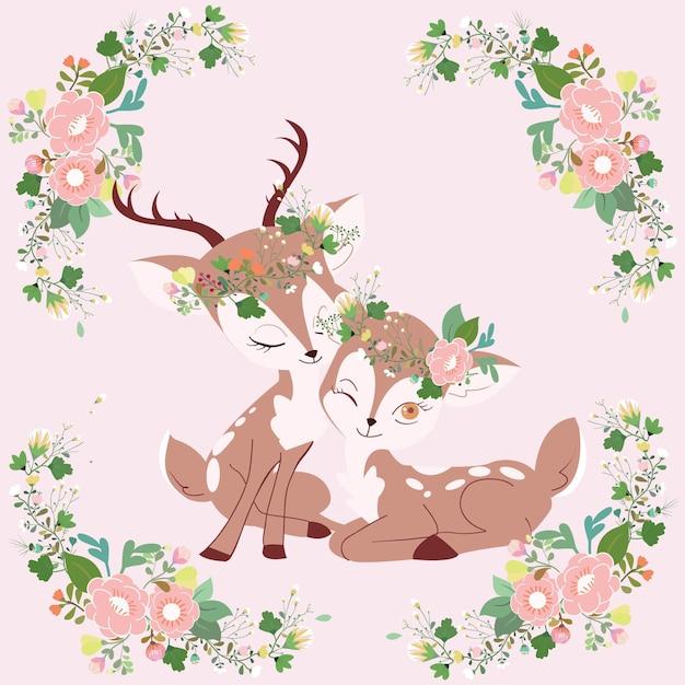 花のフレーム漫画でかわいいカップル鹿。 Premiumベクター