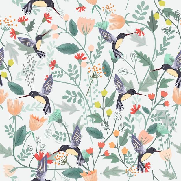 花の森のシームレスパターンで美しい鳥。 Premiumベクター