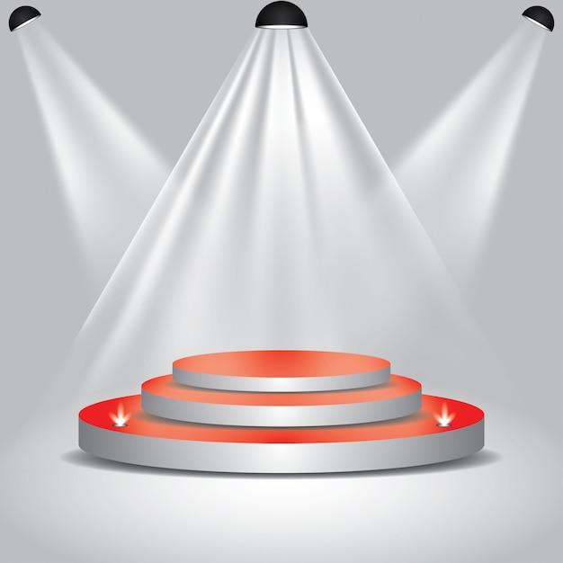 Красная дорожка к подиумной сцене с прожекторами Premium векторы