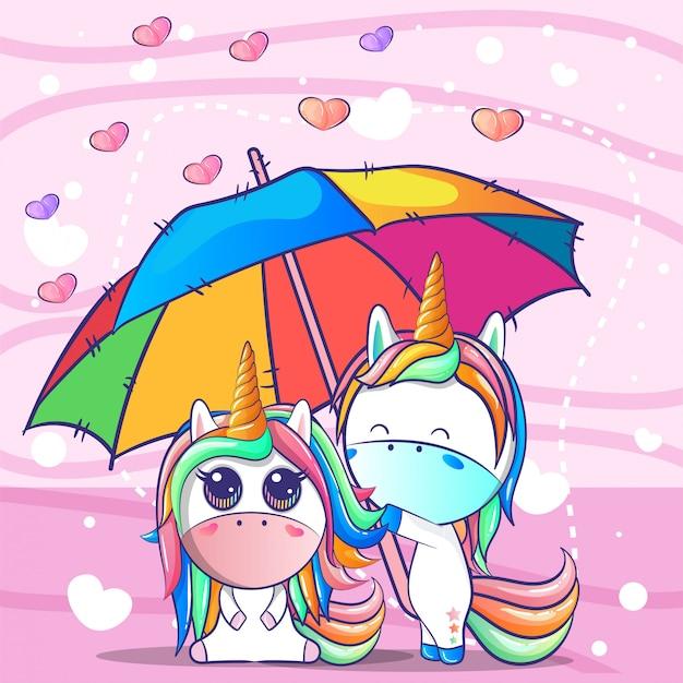 Пара единорогов под зонтиком Premium векторы
