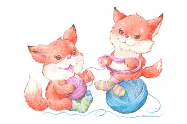 毛糸の玉とニットソックスで水彩のかわいい漫画キツネ Premiumベクター