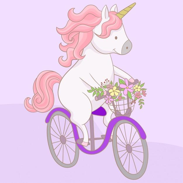 Единорог на велосипеде Premium векторы