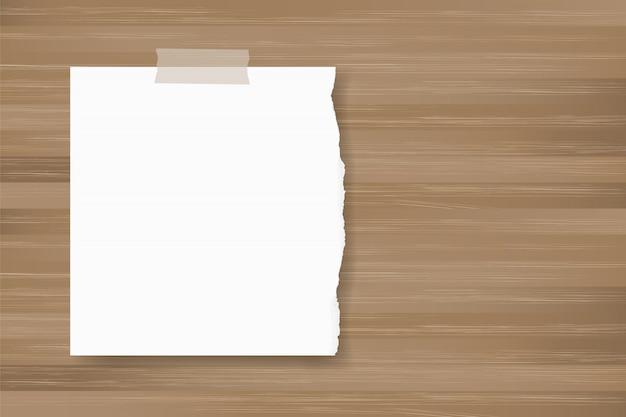 木のテクスチャに紙の背景スティックを裂いた。 Premiumベクター