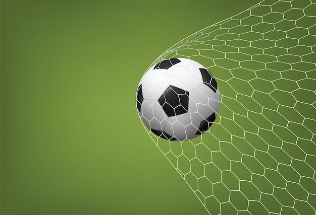 Футбол футбольный мяч в цель с белой сеткой и фоном зеленого поля Premium векторы