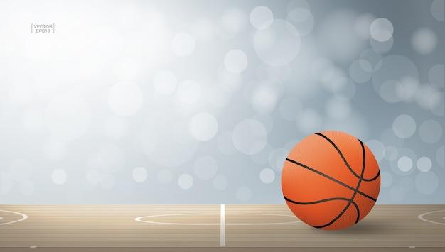 木製のコートエリアにバスケットボールボール。 Premiumベクター