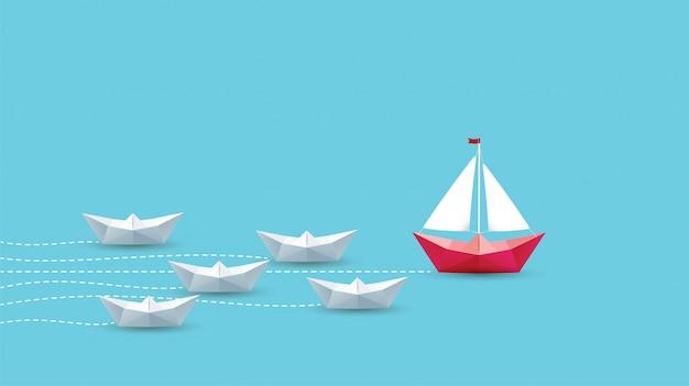 Концепция лидерства, оригами красный бумажный кораблик. Premium векторы
