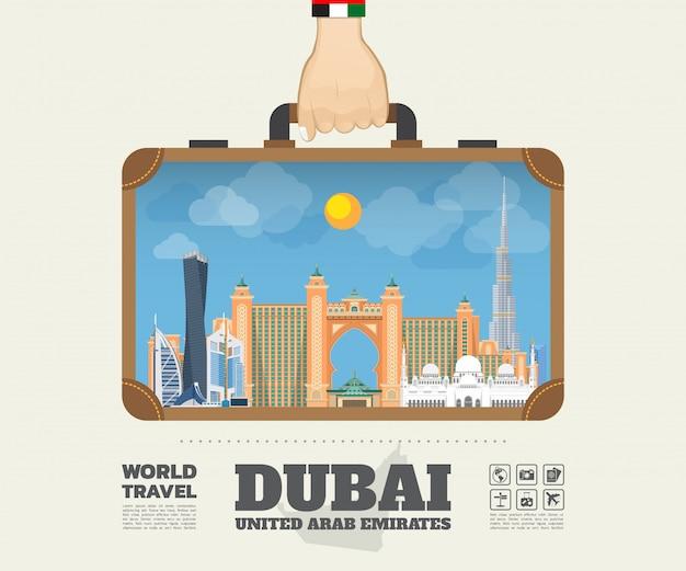 ドバイのランドマーク世界旅行と旅のインフォグラフィックバッグを運ぶ手。 Premiumベクター