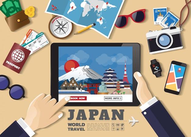 スマートデバイス予約旅行先を持っている手。日本の有名な場所 Premiumベクター