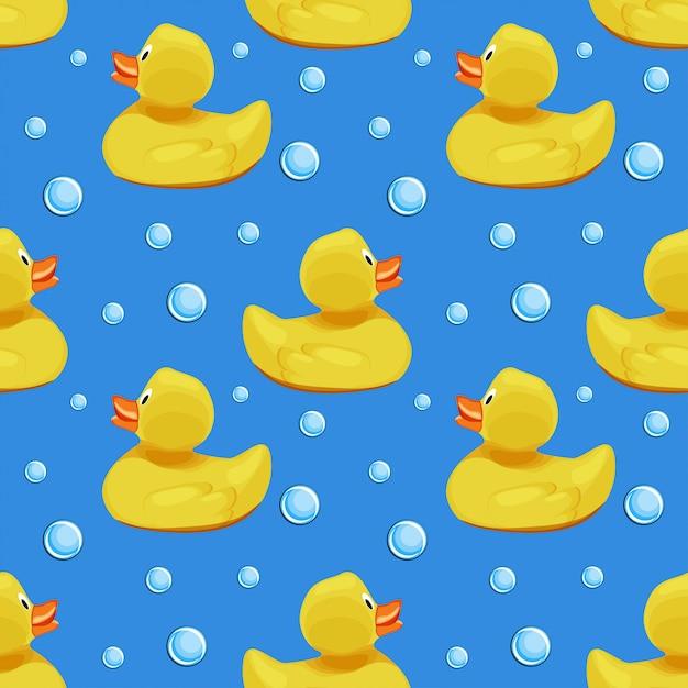 かわいい黄色のゴム製のアヒル、アヒルの子、青い水背景シームレスパターンのシャボン玉。 Premiumベクター