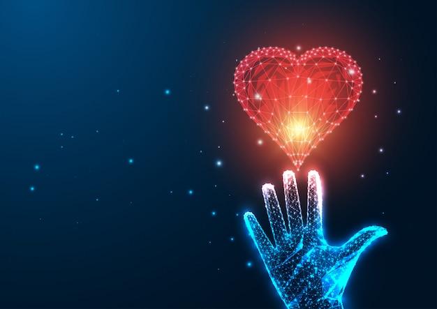 Футуристическая концепция любви с пылающей низкой многоугольной женской рукой, достигающей красного сердца Premium векторы