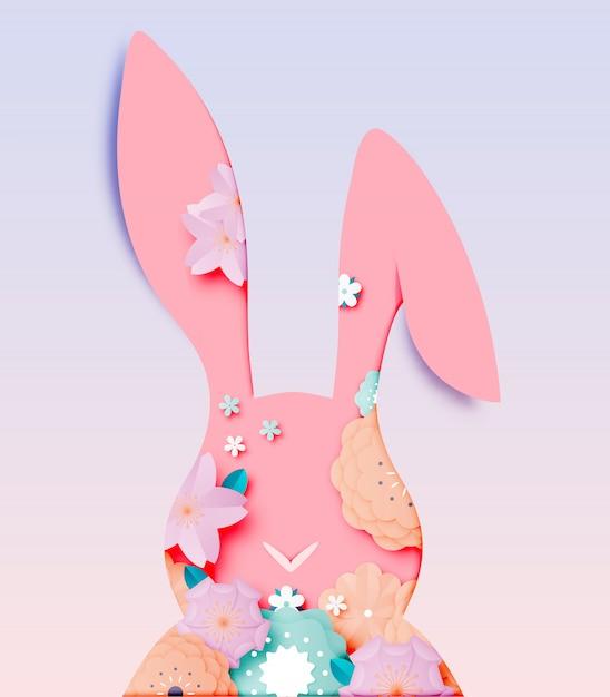 バニーと卵のベクトルイラスト紙アートスタイルでハッピーイースターの日 Premiumベクター