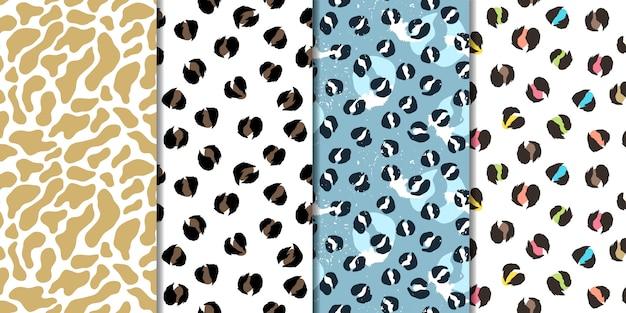 Набор векторных бесшовные шаблоны. леопард, жираф Premium векторы