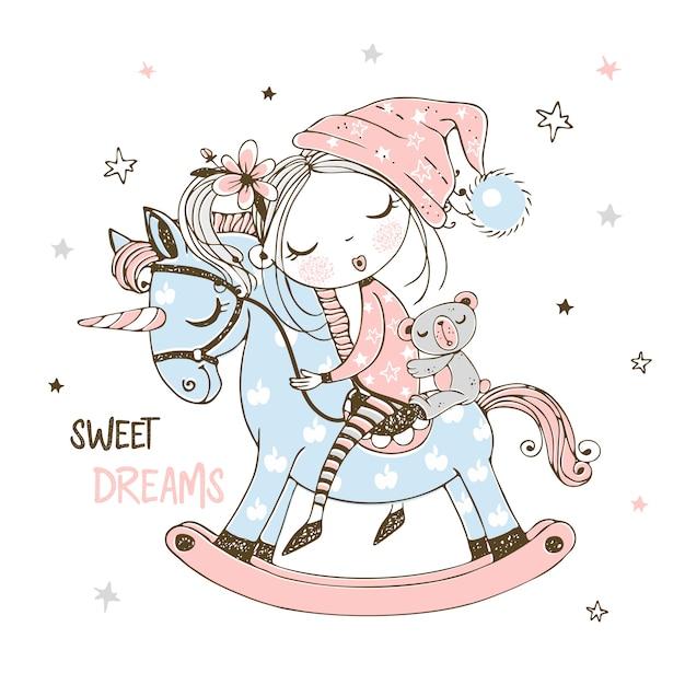 かわいい女の子がユニコーンのおもちゃの馬で甘く寝ています。 Premiumベクター