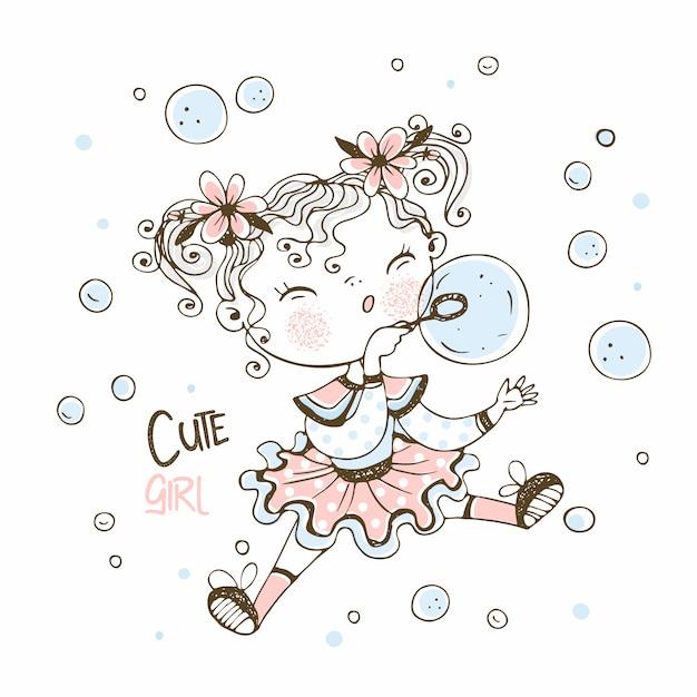 Милая маленькая девочка дует мыльные пузыри. Premium векторы